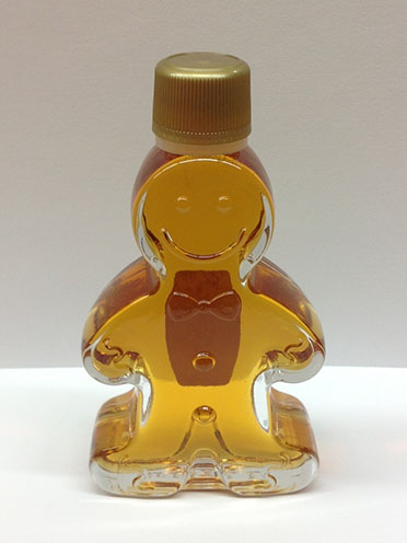 maple syrup in a gingerbread man bottle